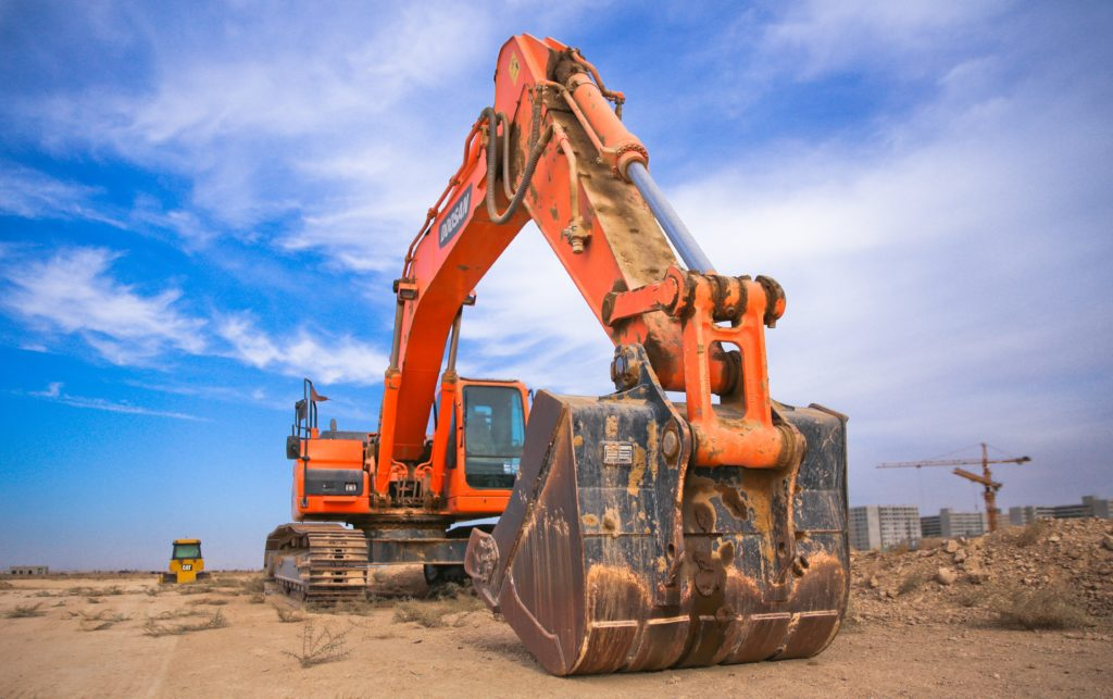 Excavator with hardface wear plate